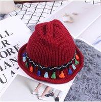 Wholesale 2016 Women Hats Hat female tassel wool hat in winter to keep warm tide folding fisherman cap basin cap female earmuffs knitted cap