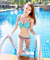 Wholesale Split hot spring swimsuits female swimsuits bikini steel towers gather large chest small chest gather multi color variety of worn