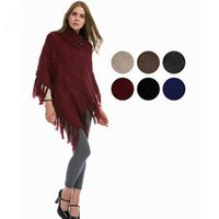 Wholesale WOMEN FASHION FISHNET KNIT TURTLENECK PONCHO SHAWL WITH LUREX INSIDE AND BUTTONS DETAILS AND TASSELS SH
