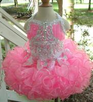 al por mayor pastel de 13 niñas-Girl's Pageant Dresses 2017 nueva falda rosada popular de la torta con el cuello del diseño de la correa de la parte posterior del arco de la belleza de los niños un envío barato