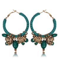 Bohemia estilo poco pendientes de aleación de aro para las mujeres Rojo / verde / negro / blanco Color elefante perlas pendientes pendientes de retorcimiento de pendientes redonda de gamuza