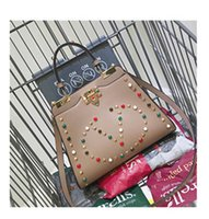 Wholesale hot sale cheap fashion rivet earopean american woman bag famle designer handbag shoulder free ship