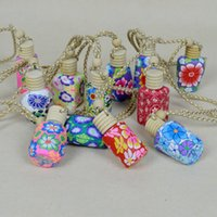 Wholesale 10 ML Refillable Hanging Polymer Clay Empty Perfume Empty Bottle Portable Essential Oil Glass Bottle Car Decoration Ornament Wood Lid Rope