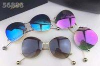 al por mayor gafas de vogue-Las gafas de sol redondas de la manera de la marca de fábrica grande 2017 de la alta calidad de la manera de la estrella de los vidrios de sol de la voga de las gafas de sol de la estrella venden el envío libre Jinnnn