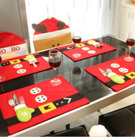 Estera de tabla de la Navidad de los HOMESTIA los 45 * 33cm de Wholesale-4pc con el cuchillo y el cojín del paño de Placemat del bolso de la bifurcación para los regalos determinados de Navidad de la decoración del hogar de la tabla de cena