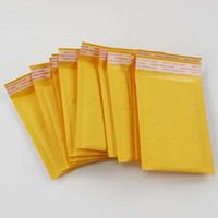 50pcs Bolsas de papel 11cm * 15cm Kraft Papeles de espuma de espuma Mailers Padded Sobres Paquete de bolsos para accesorios de joyería Reloj de regalo Papelaria