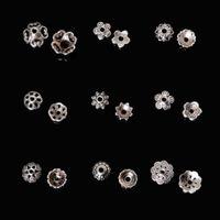 al por mayor flor de metal para la fabricación de joyas-El grano de la flor del metal 334Pcs capsula la joyería afiligranada de la vendimia de DIY que hace los resultados mezclados plateó los accesorios de los componentes de los accesorios