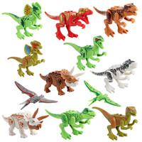 al por mayor tapas de dinosaurios-El dinosaurio superventas de 12 PC de la mini figura juguete del mundo del parque de Jurassic niños del juguete del ladrillo del bebé de los cabritos de la película libera el envío