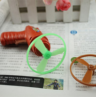 Wholesale The traditional children s toys suction card flying gun Yiwu stall shop yuan supply run wild