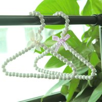 Wholesale 10 cm Fashion White Plastic Jewelry Pearl Beaded Hangers with wihte bow for baby pets dogs