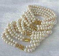 al por mayor 14k pulseras de perlas de oro al por mayor-Venta al por mayor cinco naturales 7-8m mares del sur blanco pulsera de perlas 14k cierre de oro
