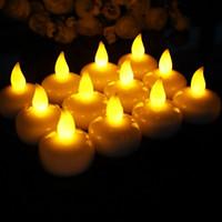 100pcs / lot capteur d'eau LED Flameless bougie électronique flottante pour le bain SPA Pray imperméable Tealight jaune