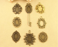 Wholesale Fit MM DIY accessories oval metal stamping blank antique cameo cabochon setting leaf dragon key pendant base bezel tray bulk