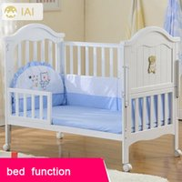 Wholesale Baby bed solid wood multifunctional cradle bed baby bed with mosquito net