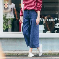 Wholesale European and American wind of new fund of autumn winters is blue loose wide legged pants women s jeans fashion nine minutes of pants