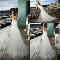 Wholesale 2017 New Mermaid Wedding Dresses Long Train Spaghetti Straps Sexy Backless Appliques Tulle Ruffles Bridal Gowns Custom Robe de marriage