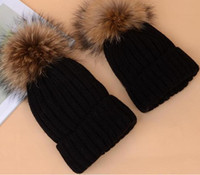 Wholesale South Korea s new winter raccoon hair bulb children wool hat Baby warm warm edge parent child cap
