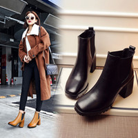 Wholesale Europe and the United States leather boots high heeled Martin boots autumn and winter new sexy head with thick female boots
