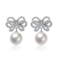Wholesale Romantic Zircon inlaid Bow Man made Pearl Pendant Plug in Earrings Imitation Rhodium Plated Brass Inside CMX1 CM Fashion Lady Used