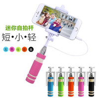 Wholesale NEW Foldable Super Mini Wired Selfie Stick Handheld Extendable Monopod Built in Shutter Handle with cable for iphone samsung smart phone