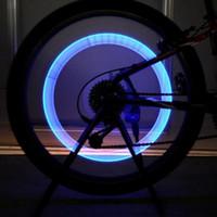 Luces del coche rojo España-100pcs / Lot novedad de la moda de coches de bicicletas LED de flash de neumáticos de la rueda de la válvula de la rueda del capó de la lámpara de la rueda de Motorbicycle luz verde azul rojo amarillo