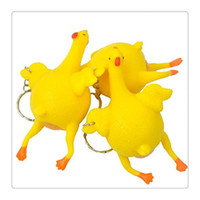 Wholesale 2017 Hot Key Chain New Stress Relief Vent Tricky Toys Squeeze Chicken Laying Egg Key Chain Funny Chicken Lay Eggs Keychains