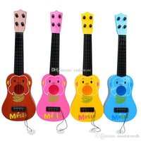 Wholesale 4 Strings Musical Plastic Toy Ukulele Small Guitar For Beginners Kids Children A00089