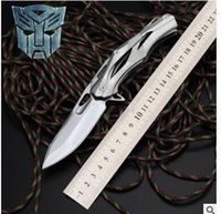 Wholesale 2017 Transformers Decepticons D2 steel handle folding knife Hunting knives blade cr18mov Hardness HRC outdoor camping tool