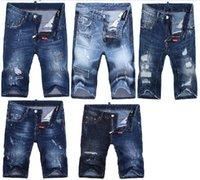 2017 Pantalones vaqueros de la marca de fábrica famosa D2 los pantalones vaqueros británicos del motorista del agujero Vaqueros flacos de lujo de los hombres de los pantalones vaqueros de Dsq la manera rasgó los cortocircuitos