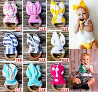 Wholesale Infant baby Teething Ring teeth Fabric and Wooden Teething training Crinkle Material Inside Sensory Toy Natural teether bell