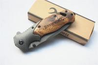 Wholesale Browning X50 Surviving Knife Tactical Folding Pocket Knife Steel Blade Wood Handle Titanium Survival Knives Huntting Fishing EDC Tool DHL