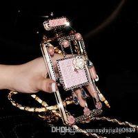 Precio de Iphone bling la rosa-084 Rhinestone de Bling hecho a mano 3D cadena larga botella de perfume de color rosa teléfono proteger la contraportada caso del teléfono móvil para el iPhone 5 / 5s 6/6 más 7/7 Plus