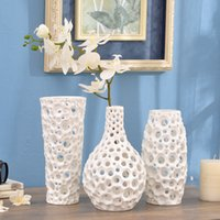 Wholesale Handmade geometry hollow emboss round dots white flower porcelain vase creative ceramic vase ornaments modern home decorations