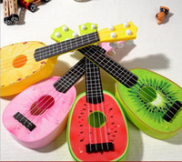 Wholesale Fancy four fruit string guitar simulation can play an instrument toys in the small Mr Kerry