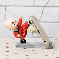 Wholesale Cartoon shaolin kung fu the young monk to mobile phones A lazy person mobile phone bracket General version creative mobile scaffold