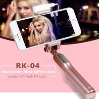 Wholesale Hot Wireless Bluetooth Selfie Stick RK04 LED Flash Fill in Light Extendable Monopod Mini Selfie Stick For iPhone Samsung