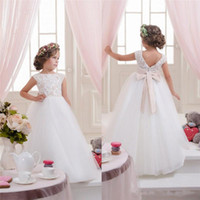 Wholesale Hot sale flower girls dresses for weddings beaded capped sleeve lace first communion dress backless bowknot long floor tulle party gown