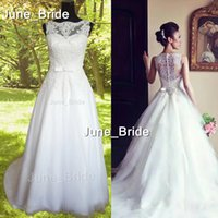 Wholesale Factory Real Photo High Quality Sexy New Sleeveless A Line Tullle Wedding Dresses Applique Beaded Court Train Bridal Gowns With Buttons Back