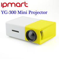 Wholesale Newest YG300 Portable LED Projector Cinema Theater PC Laptop USB SD AV HDMI Input Mini Pocket Projector ship DHL