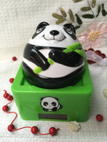 Wholesale The new non directional swing solar doll panda cute gift ornaments travel process of automotive interior head