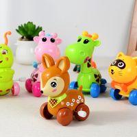 Wholesale Clockwork Wind up Tipping Children Cartoon Caterpillar Giraffe Elephant Train Toy Deer Frog Animal Wind up Toy