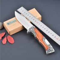 Wholesale Newest yellow pakka wood handle CR13MOV blade Liner Lock folding knife tactical knife outdoor survival knife FK A3157