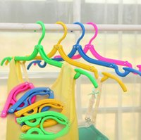 Wholesale new household helper travel camping portable foldable plastic magic hanger antislip drying racks hangers for laundry clothes