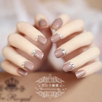 Wholesale Pure nude color false nails with diamond decoration set with glue French full nail tips short size fake nails makeup