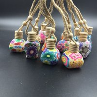 Wholesale 10ml ml Polymer Clay Ceramic essential oil bottle Car hanging decoration Car Home Hanging rope empty Perfume bottle Wooden Lid Gift