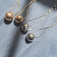 Wholesale earring modern pole chain golden ball silver ball ear clip chic