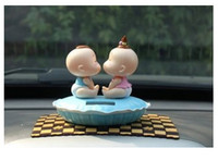 Wholesale Hot style solar doll kiss car cute act the role ofing is tasted furnishing articles Nod kiss baby Shaking his head doll kiss