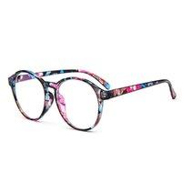 Los anteojos ópticos al por mayor del marco de los vidrios de OUTEYE con los vidrios de las mujeres transparentes claras redondas de la vendimia de los hombres del vidrio claro marcan W2