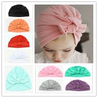 Cotton baby bunny hats - Top Selling INS Baby Bow Hat CandyColors Bunny Ear Caps Europe Style Turban Knot Head Wraps Hats Infant India Hats Kids Winter BeanieQ0821