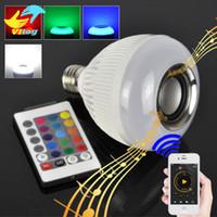 al por mayor jugando mp4-2016 E27 luz de bombilla inteligente Dimmable 12W RGBW Bluetooth inalámbrico altavoz música bulbo jugando lámpara de luz LED con 24 teclas de control remoto